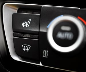 Detail of the heated seats button in a car.